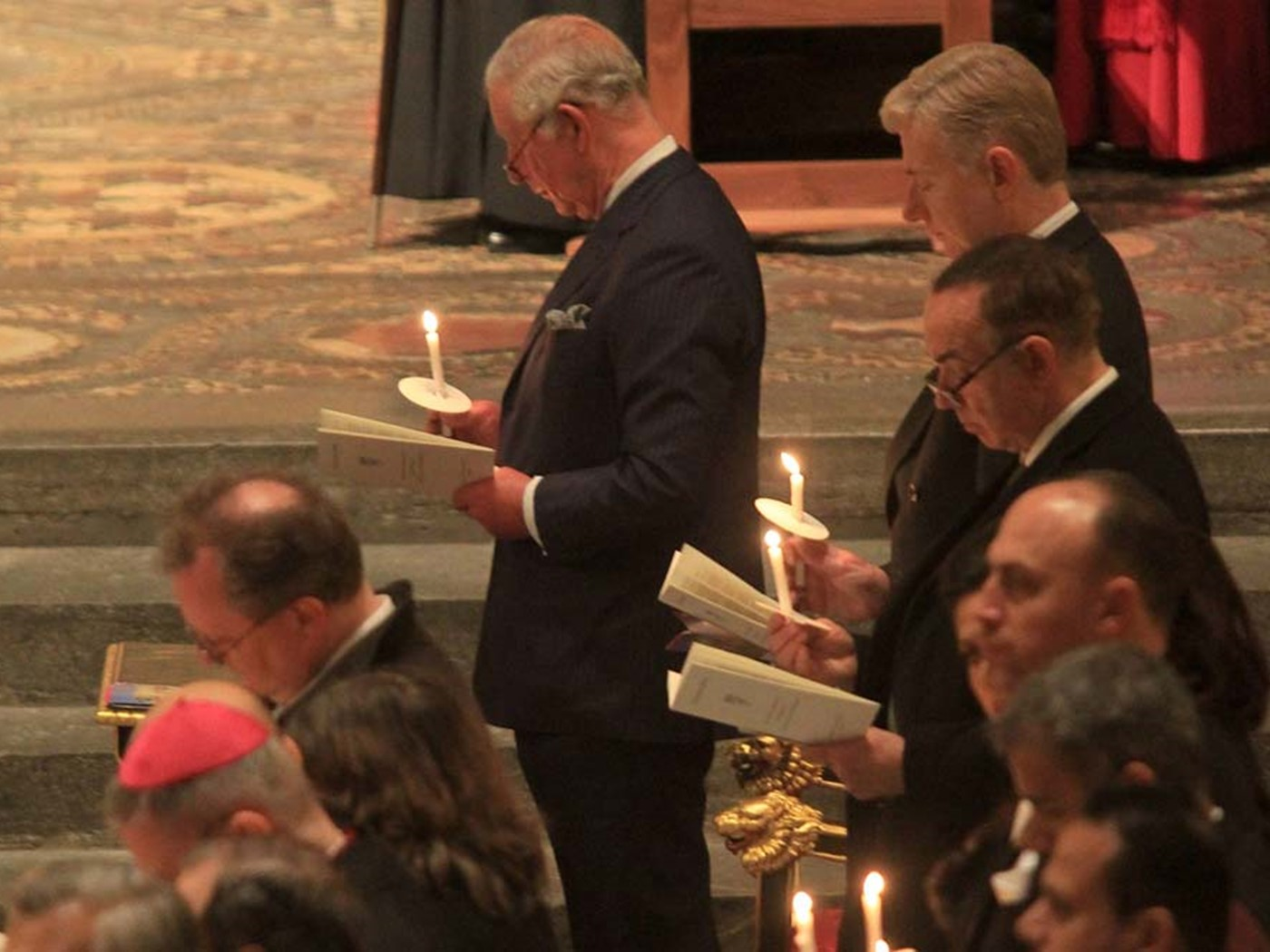 The congregation light candles
