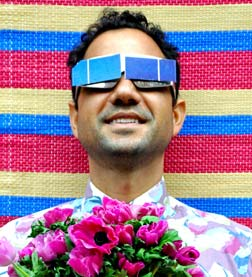 Agamemnon Otero MBE wearing solar panels over his glasses