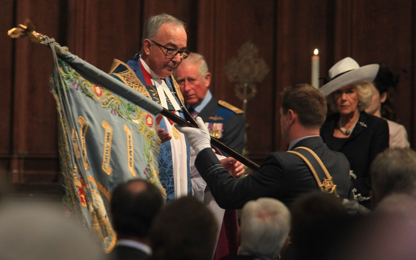 The standard of No. 72 Squadron is received by The Dean