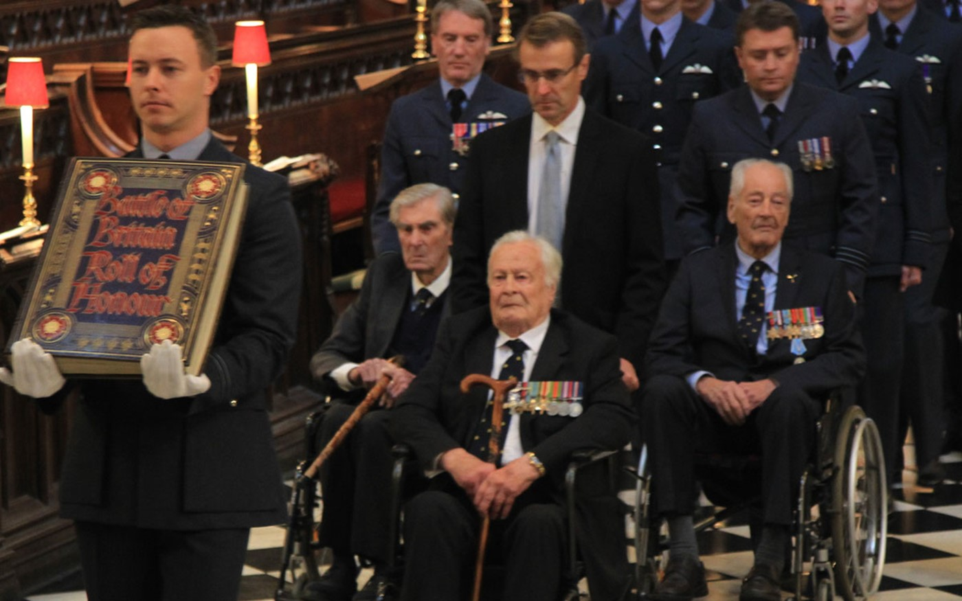 The Battle of Britain Roll of Honour is borne through the Abbey, escorted by The Battle of Britain veterans