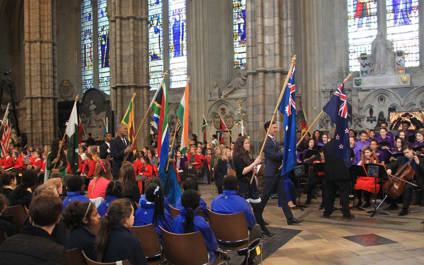 The Flags of the 52 Commonwealth nations are processed through the Abbey