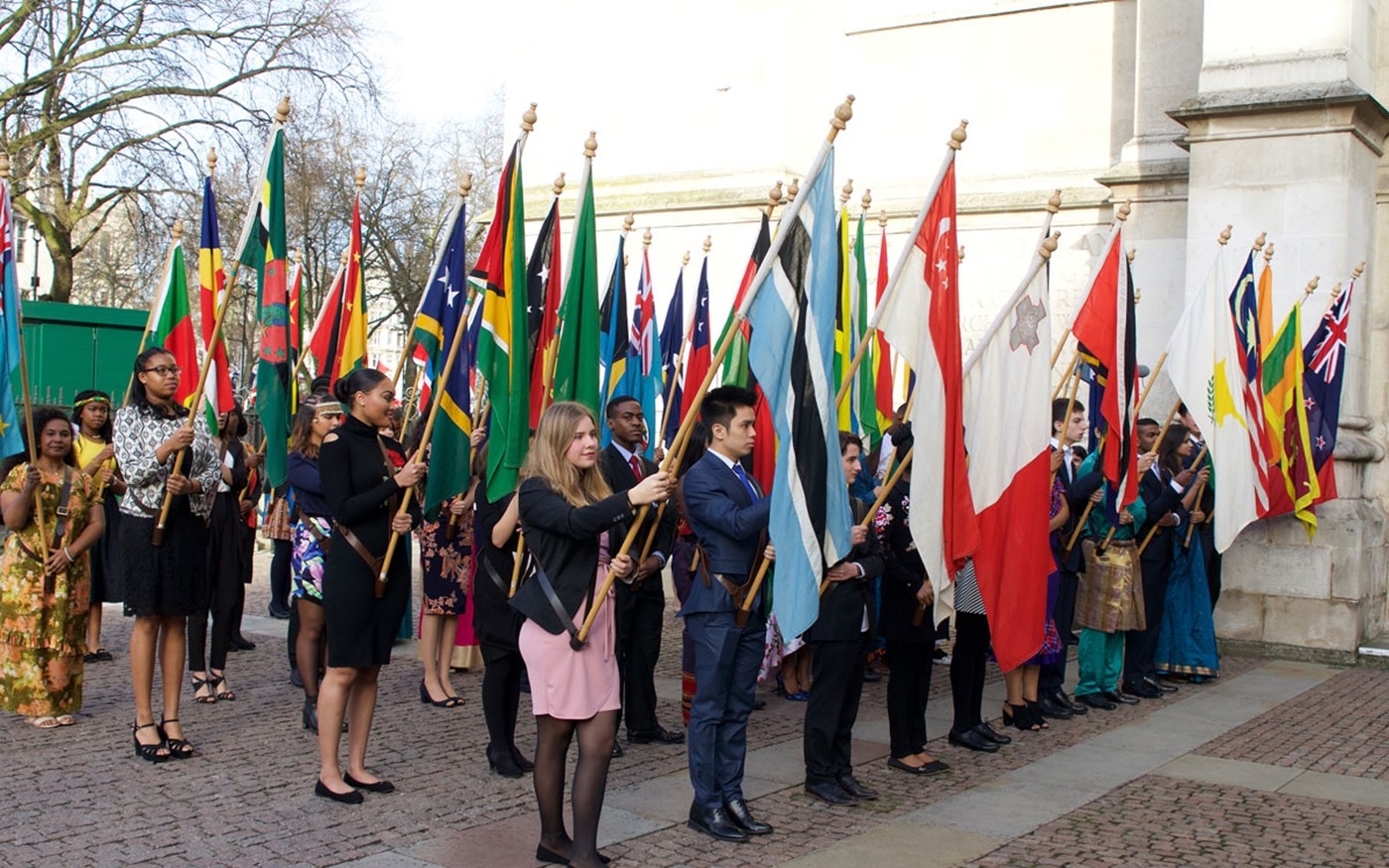 Commonwealth flag bearers line up outside the Abbey after the service