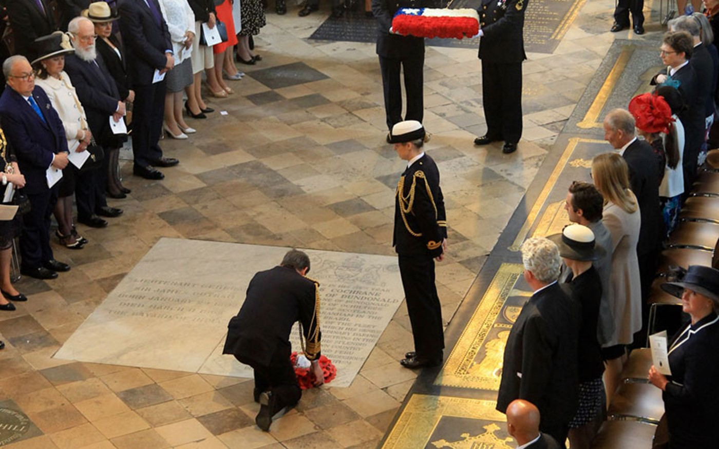 The Second Sea Lord, Vice Admiral Jonathan Woodcock OBE, lays a wreath on the grave of Admiral Thomas Cochrane, 10th Earl of Dundonald