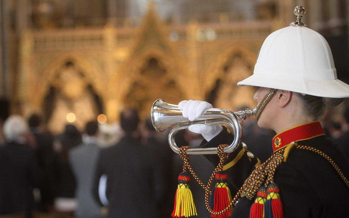 A trumpeter from the Royal Marine plays Reveille