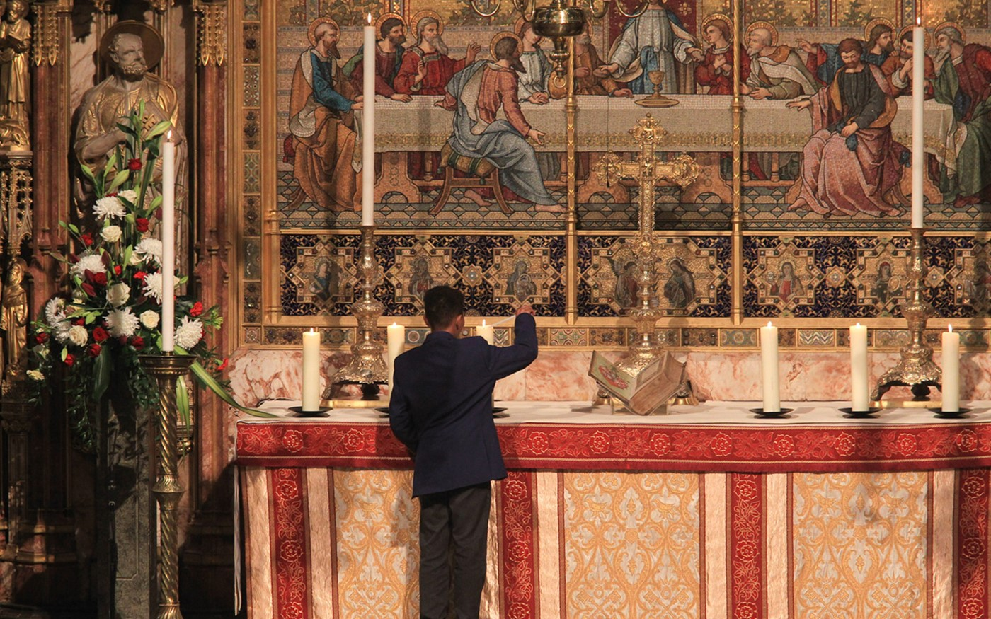 Children representing the Lutheran, Roman Catholic and Anglican Churches light candles at the High Altar