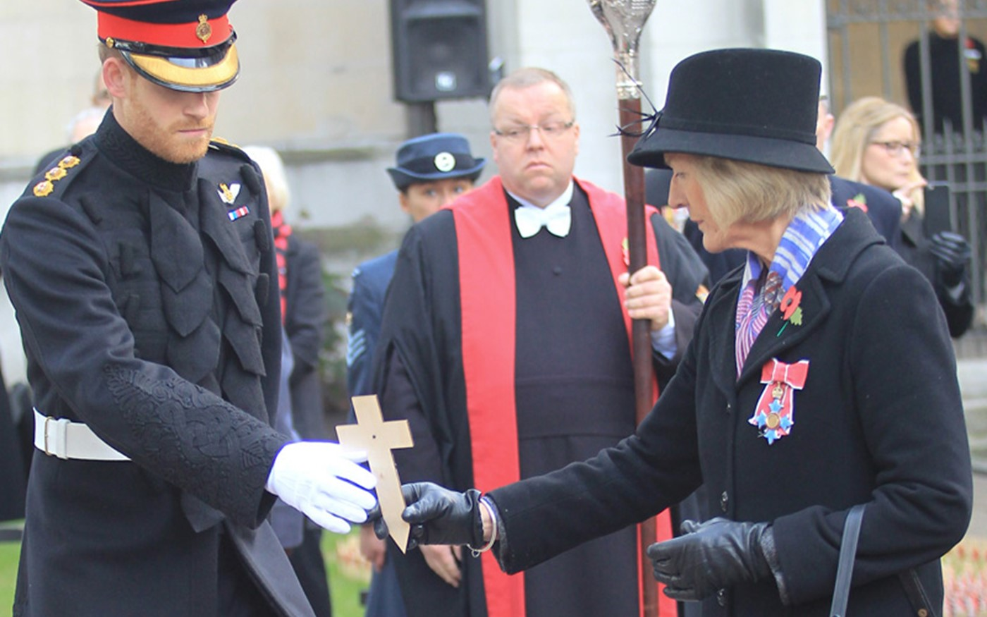 Prince Harry is invited to lay a memorial cross by Mrs Sarah Jones, President of the Royal British Legion Poppy Factory