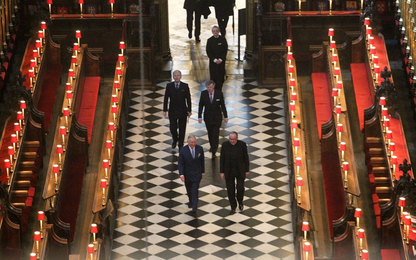HRH The Prince of Wales walks through the Quire at Westminster Abbey with the Very Reverend Dr John Hall, the Dean of Westminster