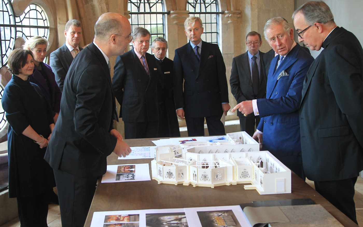 HRH The Prince of Wales meets specialists working on the project and is shown a model of the new galleries
