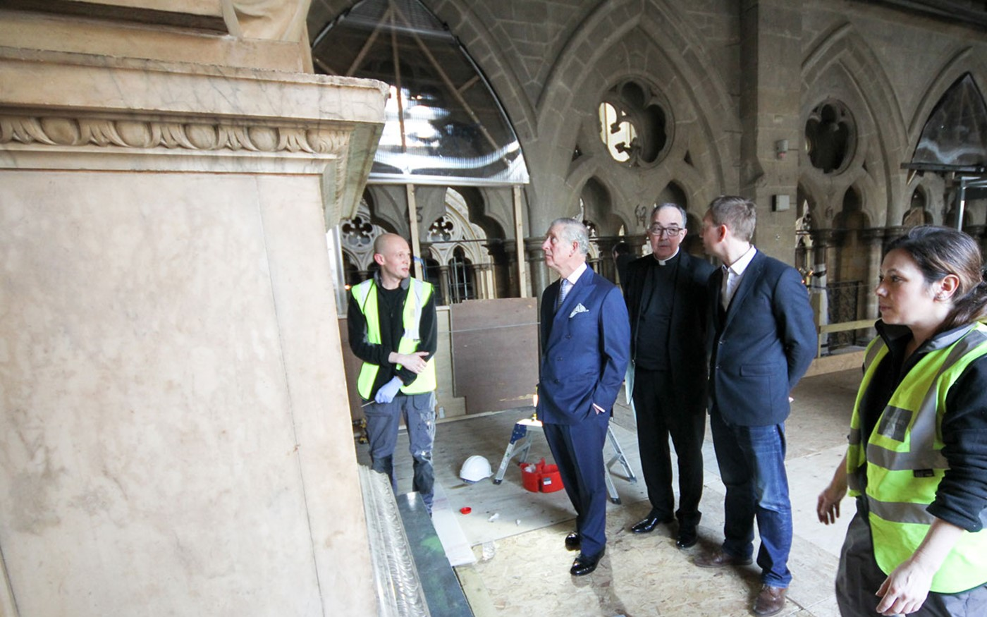 HRH The Prince of Wales views the conservation work being undertaken, and speaks to conservators