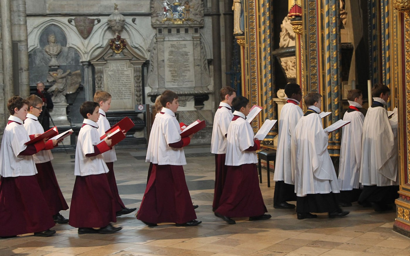 The combined choirs of Westminster Abbey, St Paul's Cathedral and Westminster Cathedral process through the Abbey