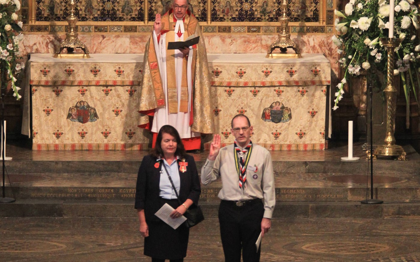 Valerie Le Vaillant, Chief Guide, and Tim Kidd, The Scouts UK Chief Commissioner, renew their Promise, joined by the Dean of Westminster, The Very Reverend Dr John Hall