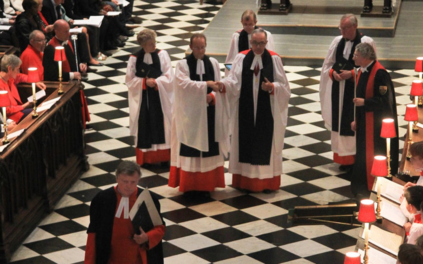 Canon Ball is led to his vacant stall in the Quire of the Abbey Church by the Dean of Westminster, the Very Reverend Dr John Hall