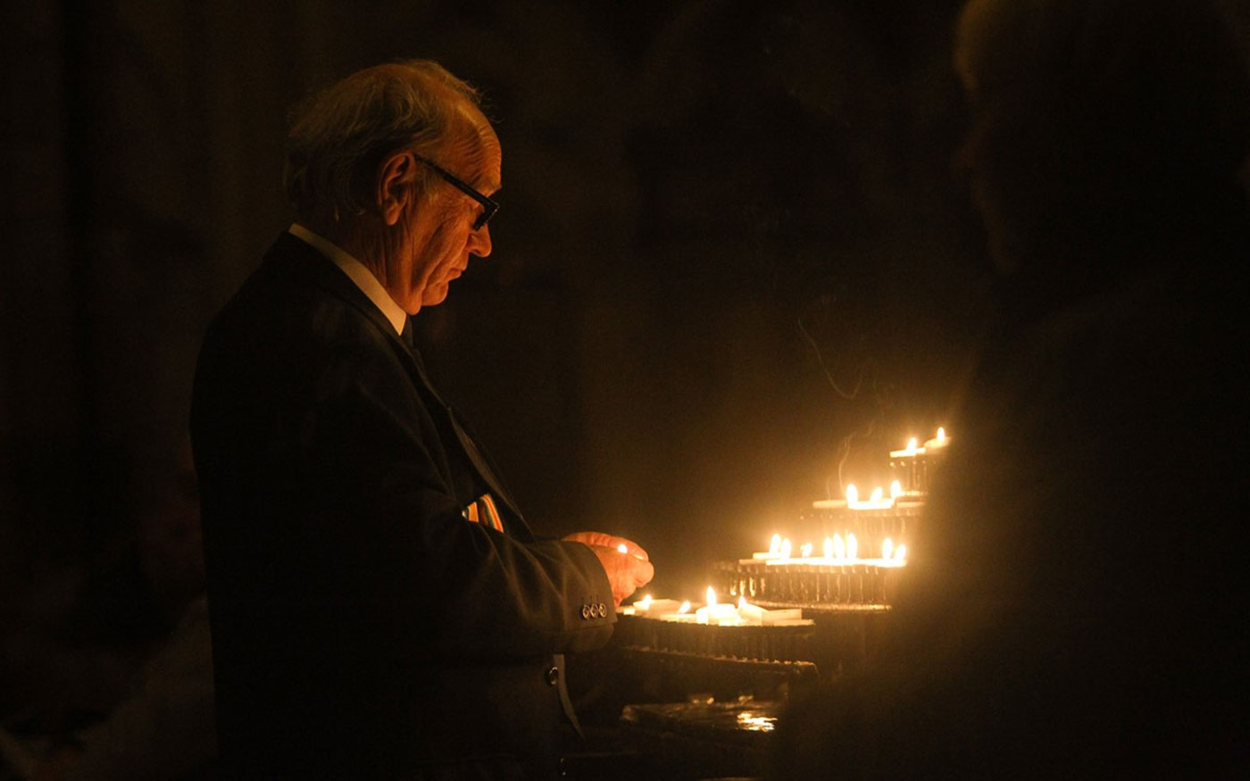 Members of the public attend the all-night Vigil and lit candles to remember the dead