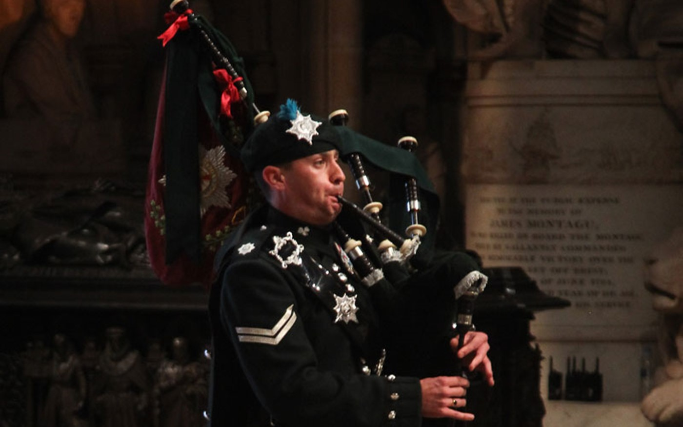 Lance Corporal Ritchie Spence, Irish Guards, plays Flowers of the Forest