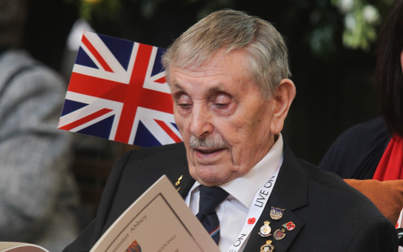 Veteran looks at the Order of Service