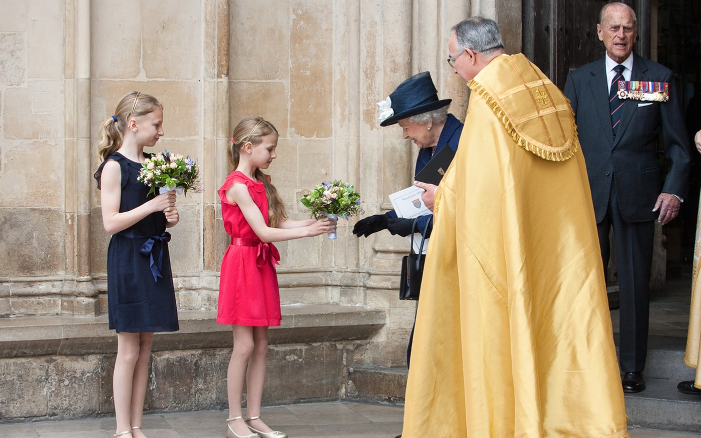 Posies are presented to Her Majesty The Queen and HRH Duchess of Cornwall