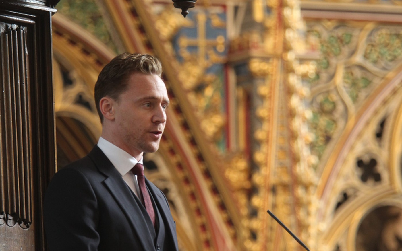 Tom Hiddlestone reads from the Nave Pulpit