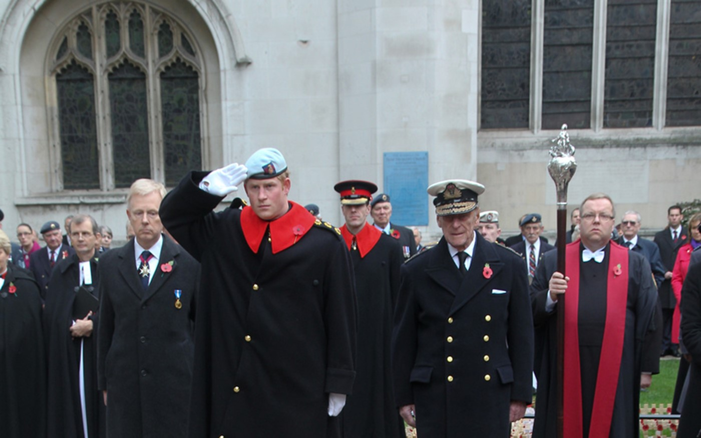 Prince Harry salutes after laying his cross of Remembrance