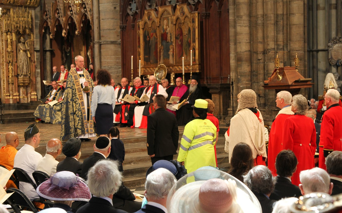 A flask of oil is carried to the High Altar by representatives of the United Kingdom where it is received by the Archbishop of Canterbury