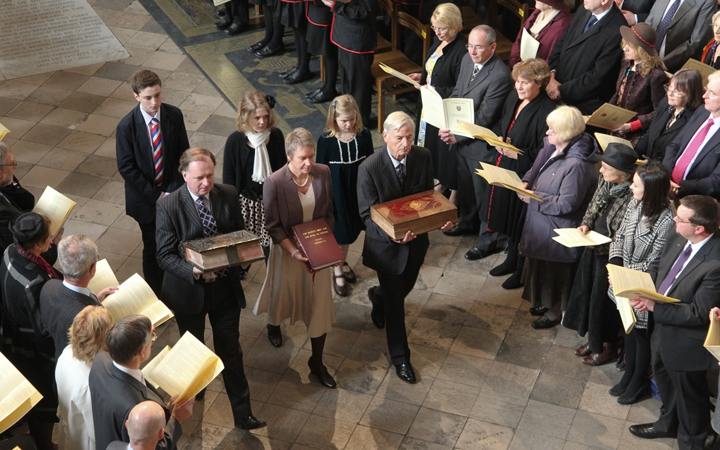 Four historic copies of the King James Bible and the People's Bible were processed through the Abbey at the start of the service.