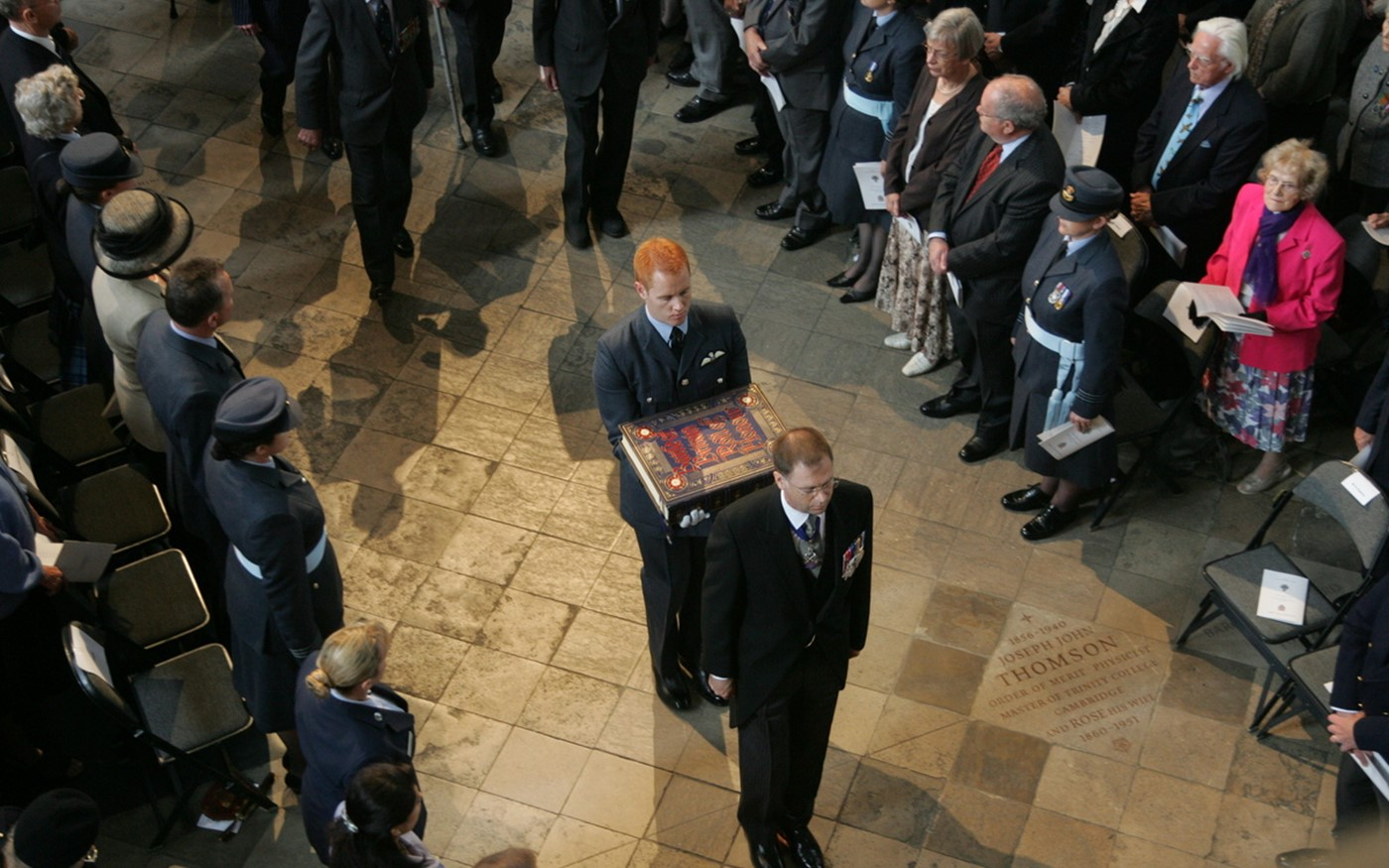 The Battle of Britain Roll of Honour is borne from the Chapel of St George to the Sacrarium, escorted by veterans of the Battle of Britain