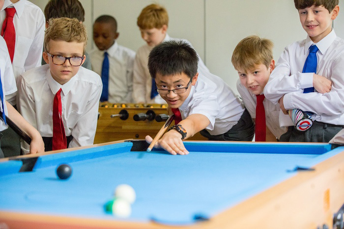 Choristers playing pool