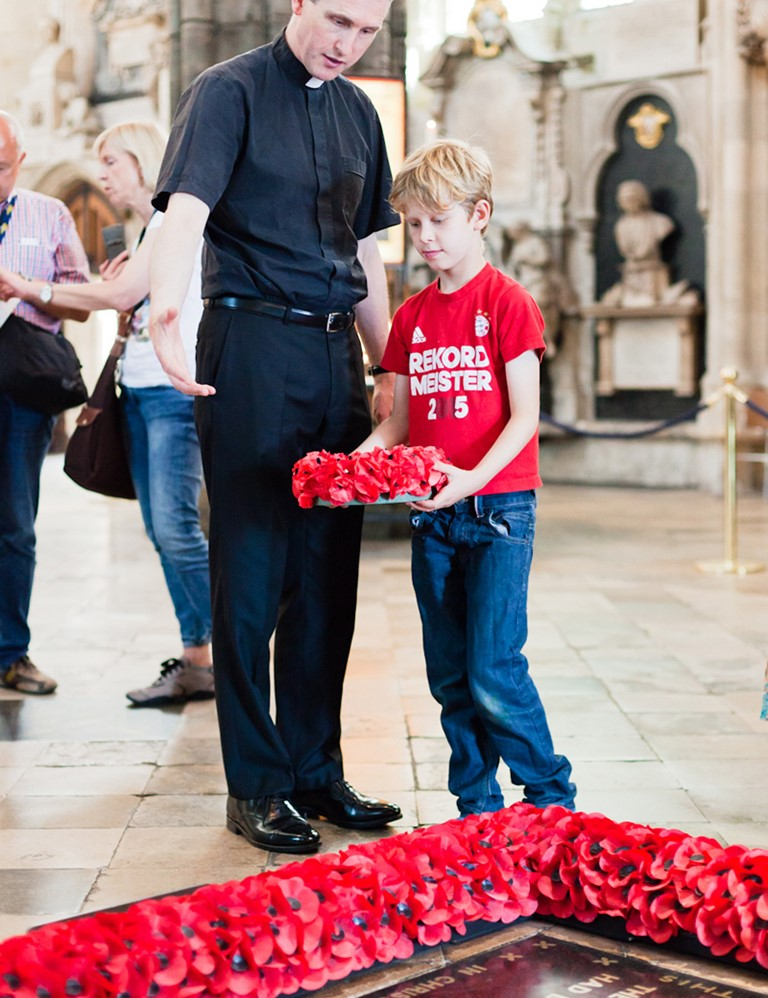 A child from one of the families was invited to lay the wreath at the foot of the Grave of the Unknown Warrior