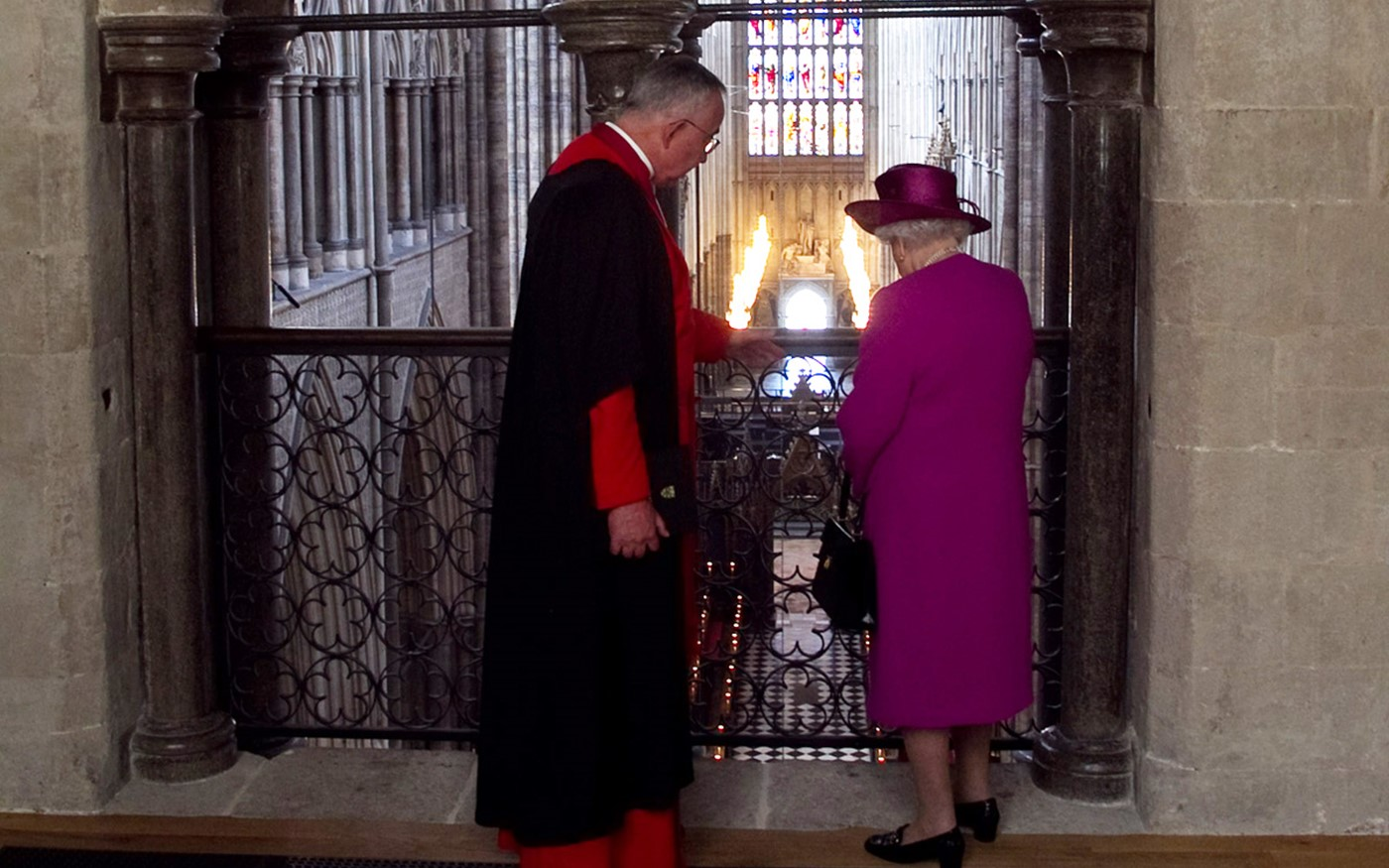 The Queen looks down into the Abbey church from the Galleries
