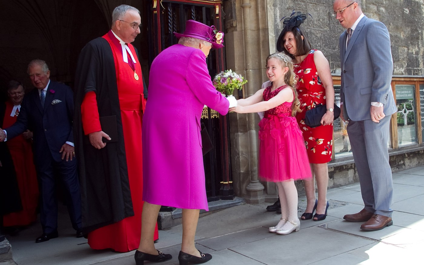 The Queen receives a posy from Sarah Bish, aged 8